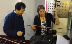 A friend learning the erhu