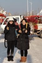 Grace and Sunny got strawberry and sweet potato tang hu lu.